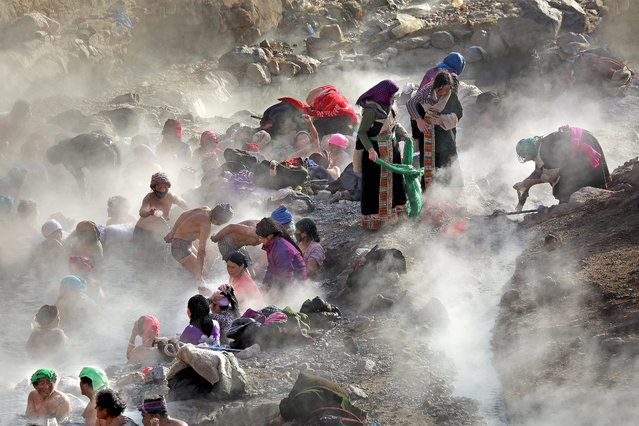 """Magical Hot Springs"". In a remote village of Gui De, China, People believe these hot springs are magical and they can cure many ailments and diseases. They walked hundreds of miles to sock in these magical hot springs of Gui De. Photo location: Gui De, Qing Hai Province, China. (Photo and caption by Adam Wong/National Geographic Photo Contest)"