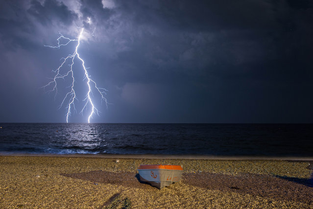 Lightning strikes during a storm over the Ionian Sea in Calabria, Italy on June 27, 2016. (Photo by Alfonso Di Vincenzo/Pacific Press/Rex Features)