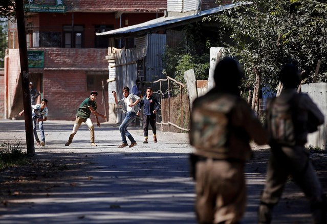 Youths hurl stones towards the Indian police during a protest against the recent killings in Kashmir, in Srinagar September 16, 2016. (Photo by Danish Ismail/Reuters)