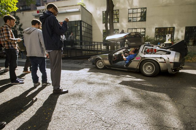 """Dom Artale parks a DeLorean Motor Company DMC-12 customized to look identical to the car used in the film """"Back to the Future Part II"""" and that will be part of a Lyft promotion in New York, October 21, 2015. (Photo by Lucas Jackson/Reuters)"""