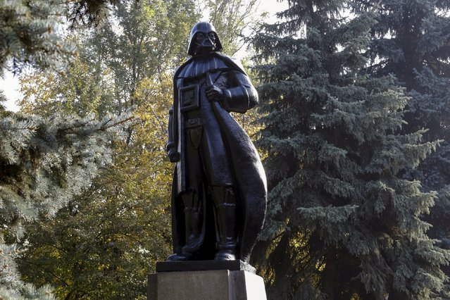 "A monument to the character of Darth Vader from ""Star Wars"", which was rebuilt from a statue of Soviet state founder Vladimir Lenin, is seen in Odessa, Ukraine, October 23, 2015. The Internet Party of Ukraine's main candidate, a person named for the legendary ""Star Wars"" villain Darth Vader, campaigned in Odessa, cruising through town on a black van to the sound of Imperial March from ""Star Wars"" saga. (Photo by Yevgeny Volokin/Reuters)"