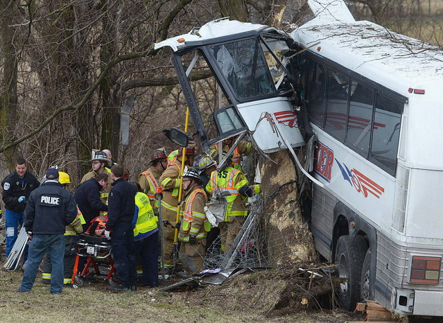 Emergency and rescue crews respond to the scene of a tour bus crash on the Pennsylvania Turnpike on Saturday, March 16, 2013 near Carlisle, Pa.  Authorities say the tour bus crashed on the freeway at mile marker 227 in central Pennsylvania, and serious injuries have been reported. Megan Silverstram of the Cumberland County public safety department says the crash in the eastbound lanes of the Pennsylvania Turnpike was reported just before 9 a.m. Saturday. She says there are reports of multiple injuries, including that some are serious. (Photo by Jason Malmont/AP Photo/The Sentinel)