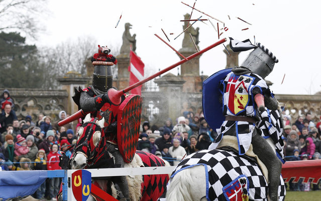 Performers dressed as medieval knights joust at Knebworth House in Hertfordshire April 1, 2013. Knebworth House, a stately home of the Lytton family since 1490, hosted The Knights Of Royal England in their first medieval jousting tournament of the season. (Photo by Olivia Harris/Reuters)