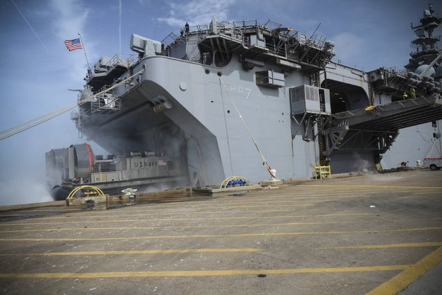 A hovercraft enters the well deck of the amphibious assault ship USS Iwo Jima (LHD 7) during an onload of more than 500 Marines from the 24th Marine Expeditionary Unit (24th MEU) and nearly 300 pallets of supplies, awaiting further tasking at Naval Station Norfolk, Virginia, U.S., on October 7, 2016 as Hurricane Matthew left flooding and wind damage in Florida before moving north to soak coastal Georgia and the Carolinas. (Photo by Courtesy Jess E. Toner/Reuters/U.S. Navy)