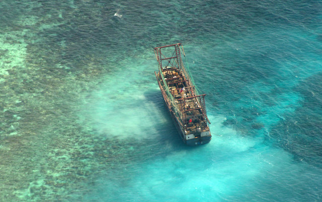 A Chinese fishing vessel that ran aground in Tubbataha Reef, a UNESCO World Heritage site, on Monday is pictured in Palawan Province, west of Manila April 10, 2013 in this picture provided by Naval Forces West. (Photo by Reuters/Naval Forces West)