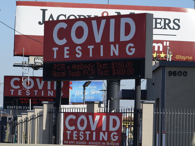 Advertisements for Covid-19 testing ares posted outside Los Angeles International Airport in Los Angeles, Friday, November 13, 2020. California has become the second state to record 1 million confirmed coronavirus infections. The governors of California, Oregon and Washington issued travel advisories Friday, Nov. 13, 2020, urging people entering their states or returning from outside the states to self-quarantine to slow the spread of the coronavirus, California Gov. Gavin Newsom's office said. The advisories urge people to avoid non-essential out-of-state travel, ask people to self-quarantine for 14 days after arriving from another state or country and encourage residents to stay local, a statement said. (Photo by Damian Dovarganes/AP Photo)