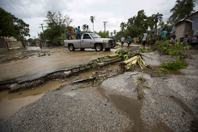 A truck negotiates a road damaged by Hurricane Matthew, in Petit Goave, Haiti, Wednesday, October 5, 2016. Rescue workers in Haiti struggled to reach cutoff towns and learn the full extent of the death and destruction caused by Hurricane Matthew as the storm began battering the Bahamas on Wednesday and triggered large-scale evacuations along the U.S. East Coast. (Photo by Dieu Nalio Chery/AP Photo)