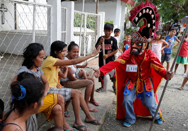 "A penitent called ""Morion"" greets residents during the start of Holy Week celebrations in Pola Oriental Mindoro in Philippines March 26, 2018. (Photo by Erik De Castro/Reuters)"