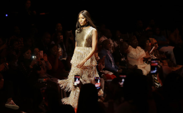 Naomi Campbell, British supermodel, displays an outfit by Nigerian designer Lanre Da Silva Ajayi during the ARISE Fashion Week event in Lagos, Nigeria Saturday, March. 31, 2018. (Photo by Sunday Alamba/AP Photo)