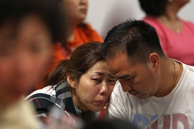 Family of passengers onboard AirAsia flight QZ8501 react at a waiting area in Juanda International Airport, Surabaya December 28, 2014. Indonesia's air force was searching for the AirAsia plane carrying 162 people that went missing on Sunday after the pilots asked to change course to avoid bad weather during a flight from the Indonesian city of Surabaya to Singapore. The Airbus 320-200 lost contact with Jakarta air traffic control at 6:17 a.m. (23:17 GMT), officials said. (Photo by Reuters/Beawiharta)