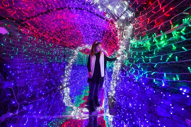"Eight year-old Bellami Smit visits the festive Tunnel of Lights at the Shipwreck Treasure Museum on December 3, 2020 in Charlestown, England. The tunnel is Europe""u2019s longest underground tunnel of festive lights. (Photo by Hugh Hastings/Getty Images)"