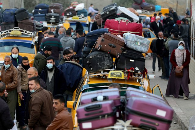 Palestinians gather around cars loaded with suitcases as passengers wait to leave Rafah border crossing with Egypt, which was reopened partially amid the spread of the coronavirus disease (COVID-19), in the southern Gaza Strip on November 24, 2020. (Photo by Ibraheem Abu Mustafa/Reuters)