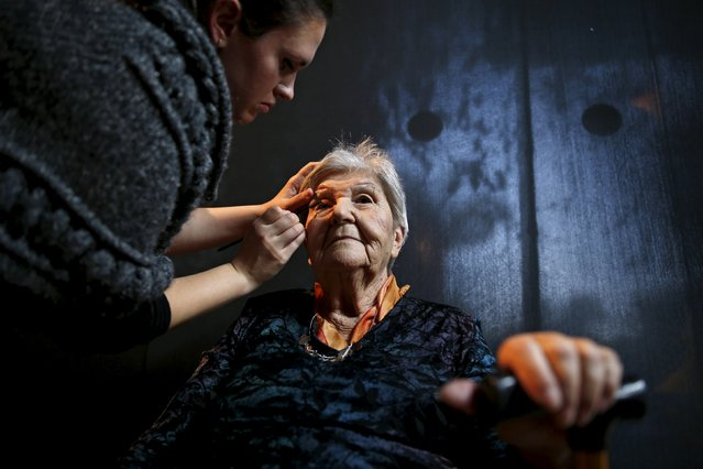Judith Rosenzweig, 81, (R) a Holocaust survivor has her make-up done during preparations ahead of a beauty contest for survivors of the Nazi genocide in the northern Israeli city of Haifa, November 24, 2015. (Photo by Amir Cohen/Reuters)