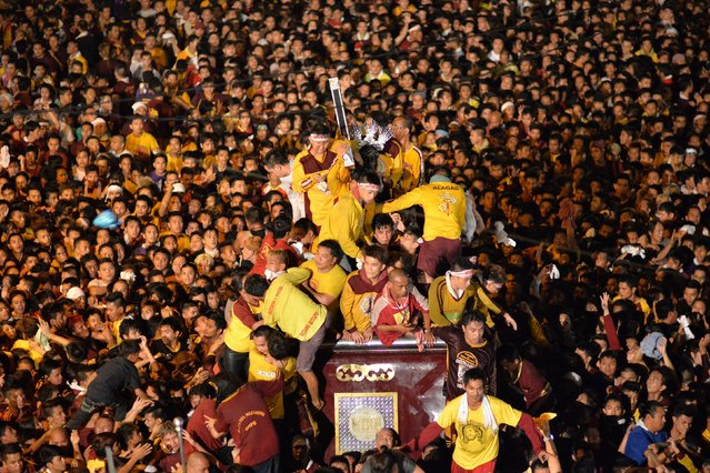 Devotees try to hold the Black Nazarene as it is pulled on a carriage during an annual procession in Manila January 9, 2015. (Photo by Ezra Acayan/Reuters)