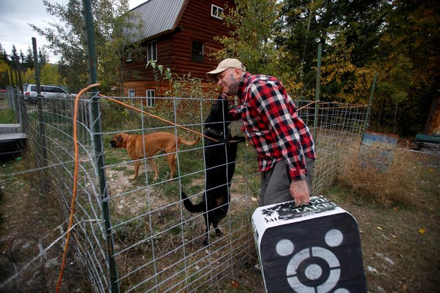 Jason Van Tatenhove, a member of the Oath Keepers, greets his dogs at his home in northern Montana, U.S. September 25, 2016. (Photo by Jim Urquhart/Reuters)