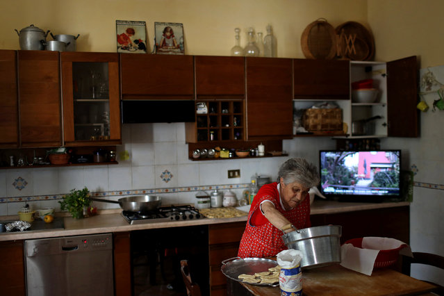 Aida Cicci Cardelli, 90,  cooks for a birthday dinner in the town of Santo Stefano di Sessanio, in the province of L'Aquila in Abruzzo, inside the national park of the Gran Sasso e Monti della Laga, Italy, September 5, 2016. (Photo by Siegfried Modola/Reuters)