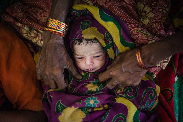 """""""20 minutes"""". Newborn child in after home delivery. Burma 2012. (Photo and caption by Mstyslav Chernov/National Geographic Traveler Photo Contest)"""