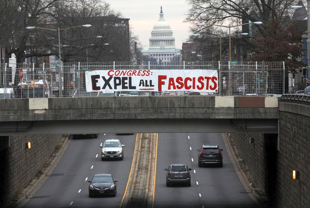 A banner with a message for members of the U.S. Congress hangs over a popular thoroughfare to the U.S. Capitol Building where members of the U.S. House of Representatives are expected to present an article of impeachment for former U.S. President Donald Trump to the U.S. Senate later today, in Washington, D.C., U.S. January 25, 2021. (Photo by Leah Millis/Reuters)