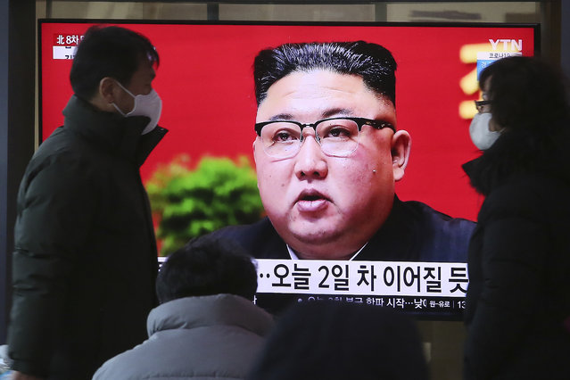 People walk by a TV screen showing North Korean leader Kim Jong Un during a ruling party congress, at the Seoul Railway Station in Seoul, South Korea, Wednesday, January 6, 2021. Kim opened his country's first ruling party congress in five years with an admission of policy failures and a vow to set new developmental goals, state media reported Wednesday. (Photo by Ahn Young-joon/AP Photo)
