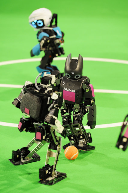 Match for the Humanoid teen size league at RoboCup 2013 in Eindhoven (NL). (Photo by Bart van Overbeeke)