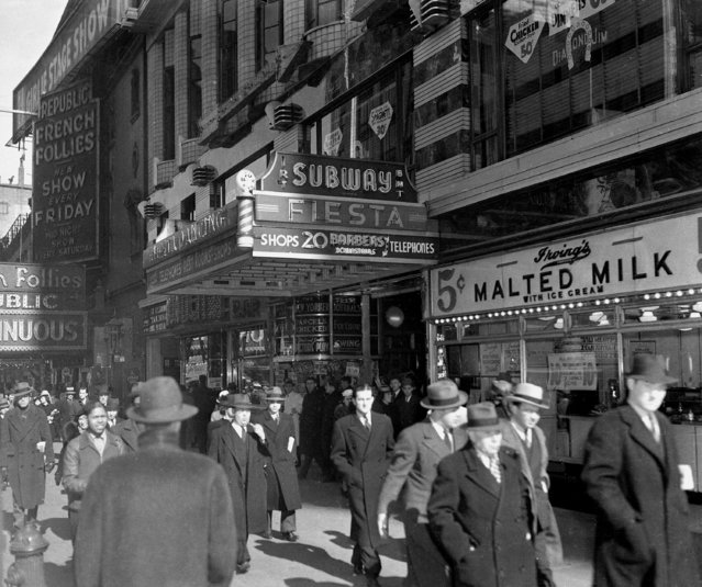 This view shows the 42nd Street subway entrance and store fronts in New York City on April 2, 1940. (Photo by AP Photo)