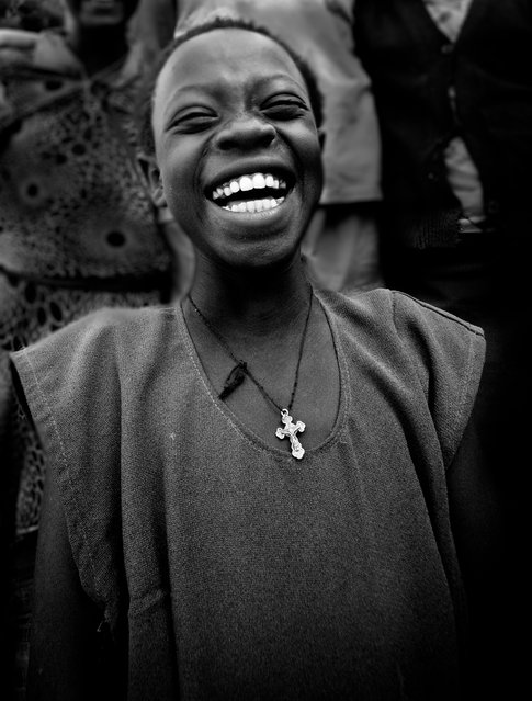 """All Smiles"". Our surgical team spent 2 weeks in the Western Highlands of Ethiopia performing obstetric fistula and uterine prolapse surgeries last November. I've never seen so many smiling ladies in a hospital before. The love and gratitude was overwhelming. This little girl was an orphan living on the hospital grounds and would come hang out with us on our breaks. Her smile and infectious laugh were an unbelievable gift. I look at this picture often and can't wait to go back next year. (Photo and caption by Kathryn Quenneville/National Geographic Traveler Photo Contest)"