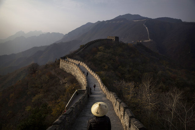 Chinese and foreign toursits walk on a section of the Great Wall of China on October 28, 2014 in Mutianyu, near Beijing, China. (Photo by Kevin Frayer/Getty Images)