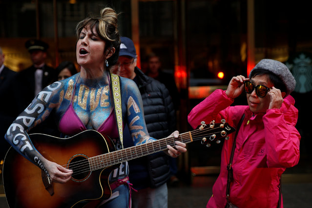 A lone protester sings outside the offices of Republican president-elect Donald Trump at Trump Tower in New York, New York, U.S. November 14, 2016. (Photo by Carlo Allegri/Reuters)