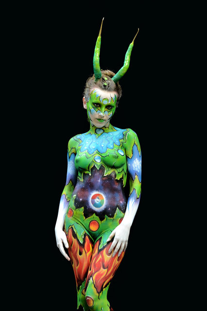 A participant poses with her body paintings designed by bodypainting artist Sandrine Lahou during the 16th World Bodypainting Festival in Poertschach on July 6, 2013 in Poertschach am Woerthersee, Austria. (Photo by Didier Messens/Getty Images)