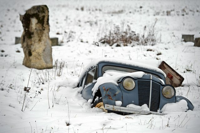 A car is buried in the snow in Bourguignon, eastern France, on February 1, 2015. (Photo by Sebastien Bozon/AFP Photo)