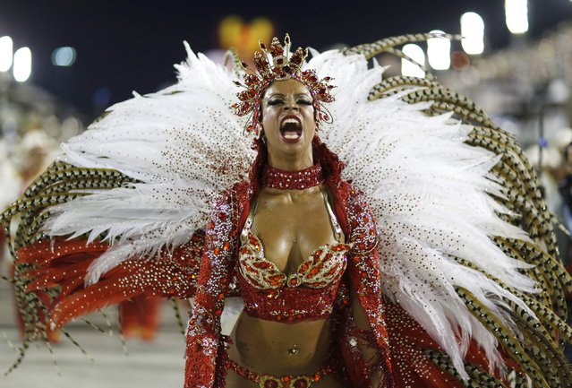 A reveller from the Alegria da Zona Sul samba school takes part in the Group A category of the annual Carnival parade in Rio de Janeiro's Sambadrome, February 14, 2015. (Photo by Pilar Olivares/Reuters)