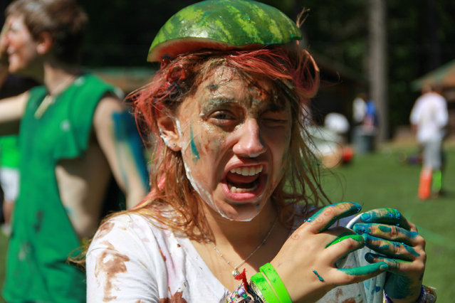 """This 2014 image provided by Maine Teen Camp in Porter, Maine, shows teenagers playing during the camp's """"Festivus"""" event, inspired by the Festivus holiday that was depicted on the old """"Seinfeld"""" TV show as an alternative to Christmas. The camp's Festivus themes change from year to year and have included NASA, zombies and superheroes. (Photo by Ant Richardson/AP Photo/Maine Teen Camp)"""