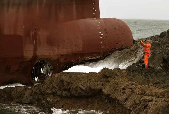 The bow of container ship Lysblink Seaways, sits on rocks after it ran aground at Kilchoan, in the West Highlands of Scotland, Wednesday February 18, 2015. (Photo by Andrew Milligan/AP Photo/PA Wire)