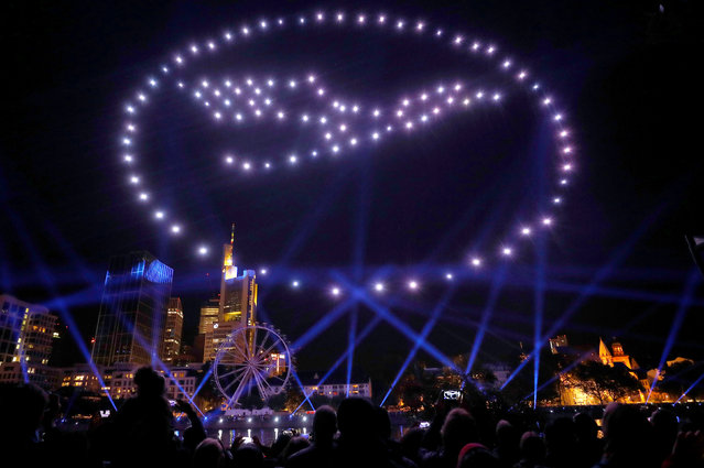 The skyline with its financial district is illuminated by drones forming the logo of German air carrier Lufthansa during an art installation celebrating the opening of the re-built old town in Frankfurt, Germany, September 29, 2018. (Photo by Kai Pfaffenbach/Reuters)