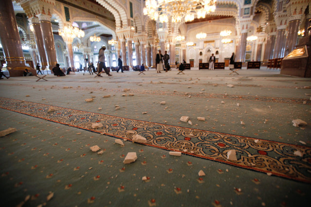 Debris are seen in the al-Saleh mosque after Saudi-led air strikes hit a military post near the mosque in Sanaa, Yemen December 14, 2016. (Photo by Khaled Abdullah/Reuters)