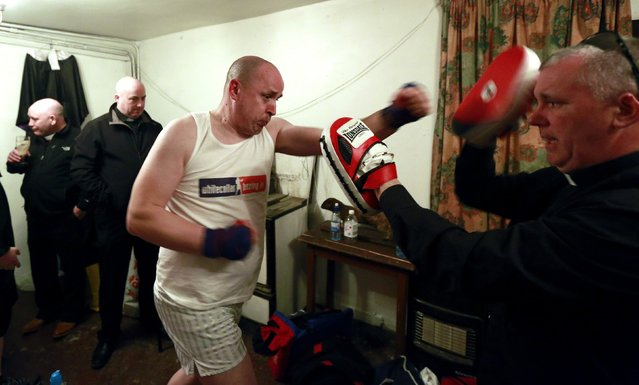 Fr Pierre Pepper (C) warms up before his amateur boxing match in the town of Banagher in County Offaly March 15, 2015. (Photo by Cathal McNaughton/Reuters)