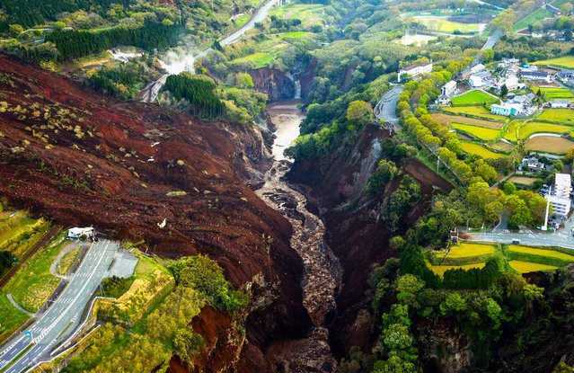 In this aerial image, Aso Ohashi Bridge is washed away by a landslide on April 16, 2016, in Minamiaso, Kumamoto, Japan. (Photo by The Asahi Shimbun via Getty Images)
