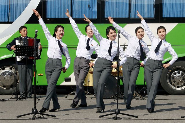 Artistes of an art squad give performance to people in front of the Pyongyang Indoor Stadium on International Women's Day in Pyongyang, North Korea Monday, March 8, 2021. (Photo by Jon Chol Jin/AP Photo)