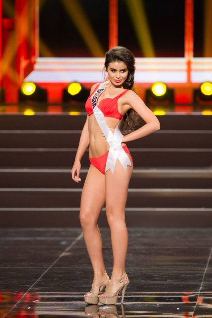 This photo provided by the Miss Universe Organization shows Elmira Abdrazakova, Miss Russia 2013, competes in the swimsuit competition during the Preliminary Competition at Crocus City Hall, Moscow, on November 5, 2013. (Photo by Darren Decker/AFP Photo)