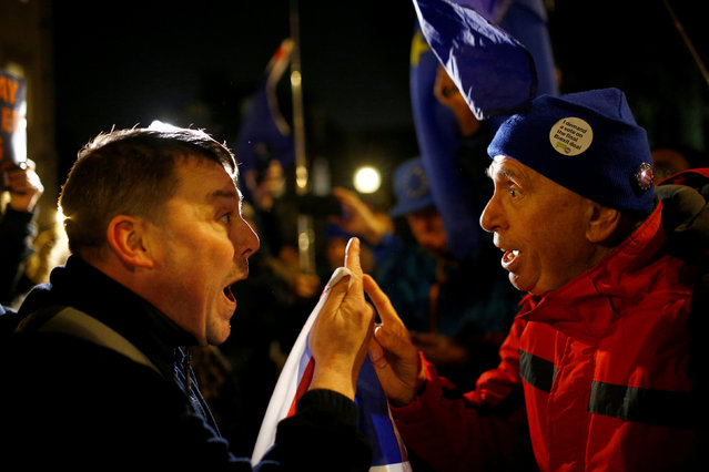 Pro-Brexit and anti-Brexit demonstrators argue with each other opposite the Houses of Parliament, in Westminster, central London, Britain December 11, 2018. (Photo by Henry Nicholls/Reuters)
