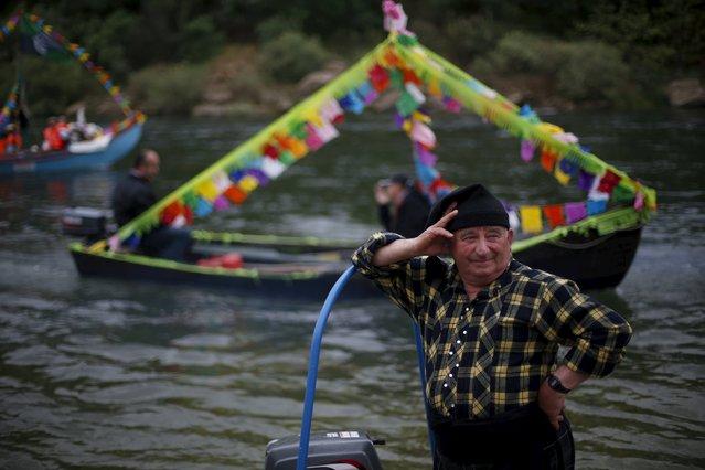 "Boats arrive to receive the benediction during the festivity of ""Nossa Senhora da Boa Viagem"", in Constancia April 6, 2015. (Photo by Rafael Marchante/Reuters)"