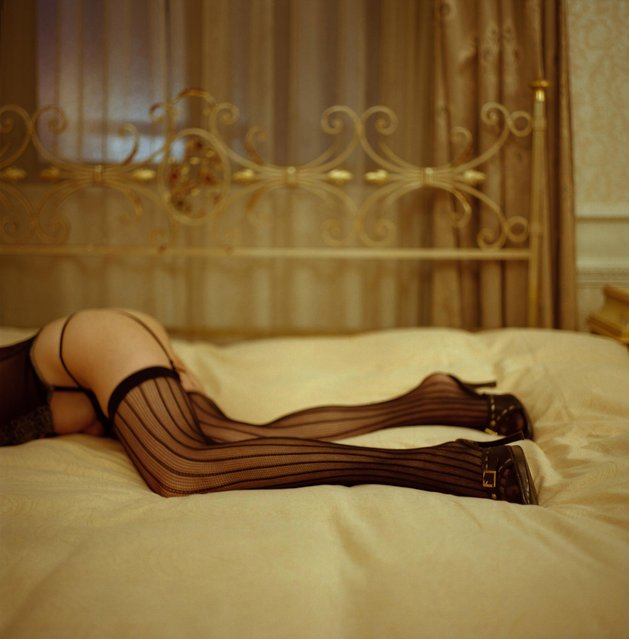 Woman wearing stocking and lying on bed. (Photo by Yukiharu/Getty Images)