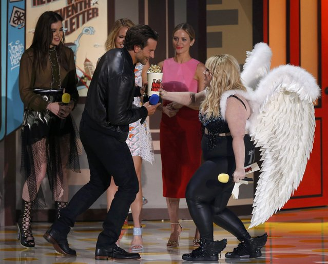 "Actress Rebel Wilson (R) presents the award for Best Male Performance to Bradley Cooper for ""American Sniper"" as Wilson's ""Pitch Perfect 2"" co-stars Hailee Steinfeld (L), Anna Camp (2nd L) and Brittany Snow watch at the 2015 MTV Movie Awards in Los Angeles, California April 12, 2015. (Photo by Mario Anzuoni/Reuters)"