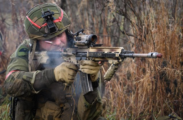 A shell case is seen as it is ejected from the gun of a Norwegian soldier as he attempts to storm an opposing British Army position, during the live exercise on November 3, 2018 in Elval, Norway. (Photo by Leon Neal/Getty Images)