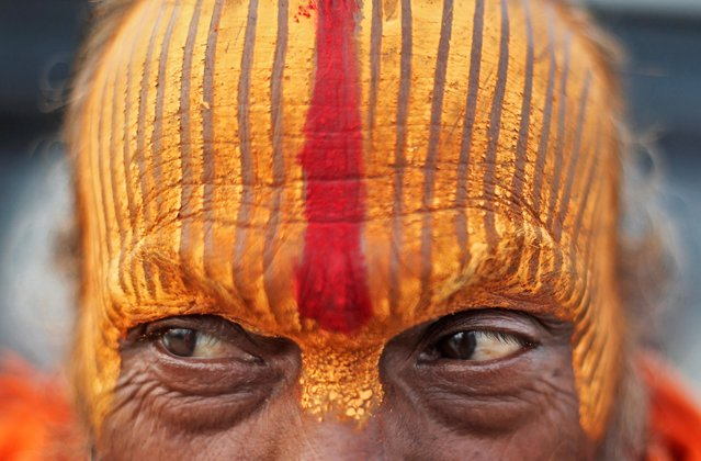 """A Sadhu or a Hindu holy man stands on the banks of the river Ganges before taking a holy dip during """"Kumbh Mela"""", or the Pitcher Festival, in Prayagraj, previously known as Allahabad, India, February 3, 2019. (Photo by Adnan Abidi/Reuters)"""