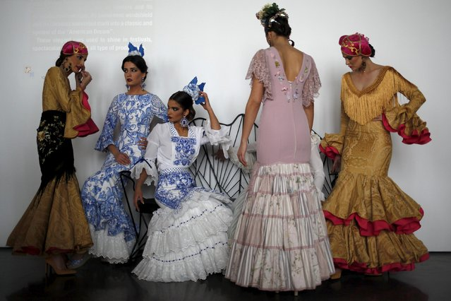 Models wearing creations by Macarena Delgado wait backstage during the International Flamenco Fashion Fair (FIMAF) in Malaga, February 27, 2016. (Photo by Jon Nazca/Reuters)