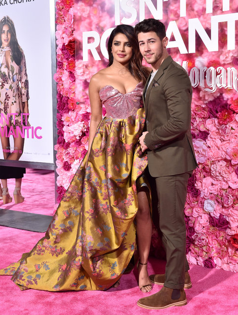 """Priyanka Chopra and Nick Jonas attend the premiere of Warner Bros. Pictures' """"Isn't It Romantic"""" at The Theatre at Ace Hotel on February 11, 2019 in Los Angeles, California. (Photo by Axelle/Bauer-Griffin/FilmMagic)"""