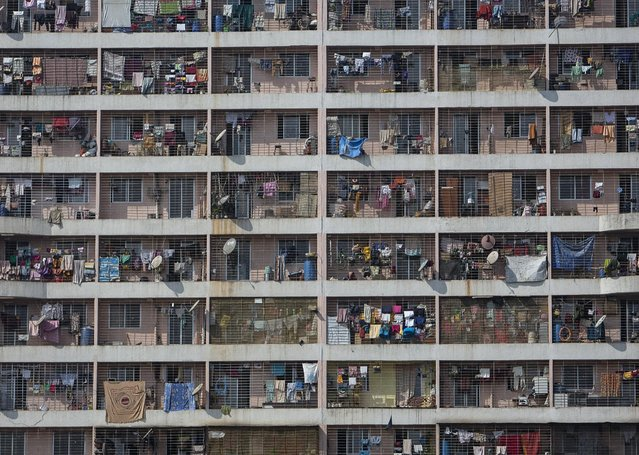 Windows of various apartments of a high-rise residential building are seen in the western suburb of Mumbai February 8, 2014. The cost for buying a 269 square feet (25 square meters) one-bedroom apartment in this building is around 9,293 Indian rupees ($ 150) per square feet or 2,500,000 Indian rupees ($ 40,000). The rent for an apartment in the same building is around 10,000 Indian rupees ($ 160) per month. (Photo by Danish Siddiqui/Reuters)