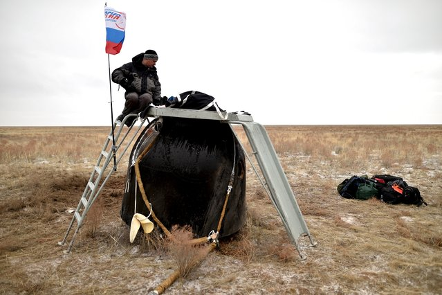 A member of a search and rescue team works at the site of landing of the Soyuz TMA-18M spacecraft, which carried International Space Station (ISS) crew members U.S. astronaut Scott Kelly, Russian cosmonauts Sergei Volkov and Mikhail Korniyenko near the town of Dzhezkazgan (Zhezkazgan), Kazakhstan, March 2, 2016. (Photo by Kirill Kudryavtsev/Reuters)