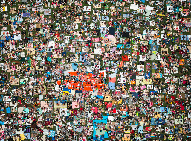"""""""Summer night"""". Bryant Park, New York, US. A sea of blankets covers the park as spectators wait for a movie night to begin on a summer evening. (Photo by Navid Baraty)"""